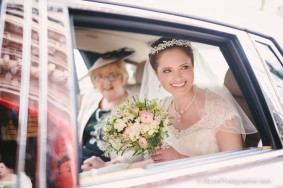 Bride and mother in wedding car