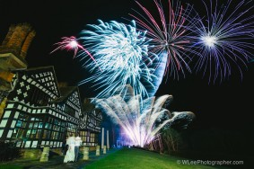 Bride and groom watching fireworks at Hillbark Hotel, Wirral