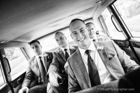 Groomsmen in a wedding car